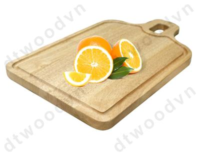 Bottle shaped cutting board with groove