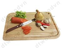 Cutting board with groove and hole